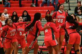 Kierra Sanderlin (20) and her Judson teammates celebrate upon defeating Clark, 48-45, in girls basketball playoff action at Canyon High School on Wednesday, Feb. 24, 2021.