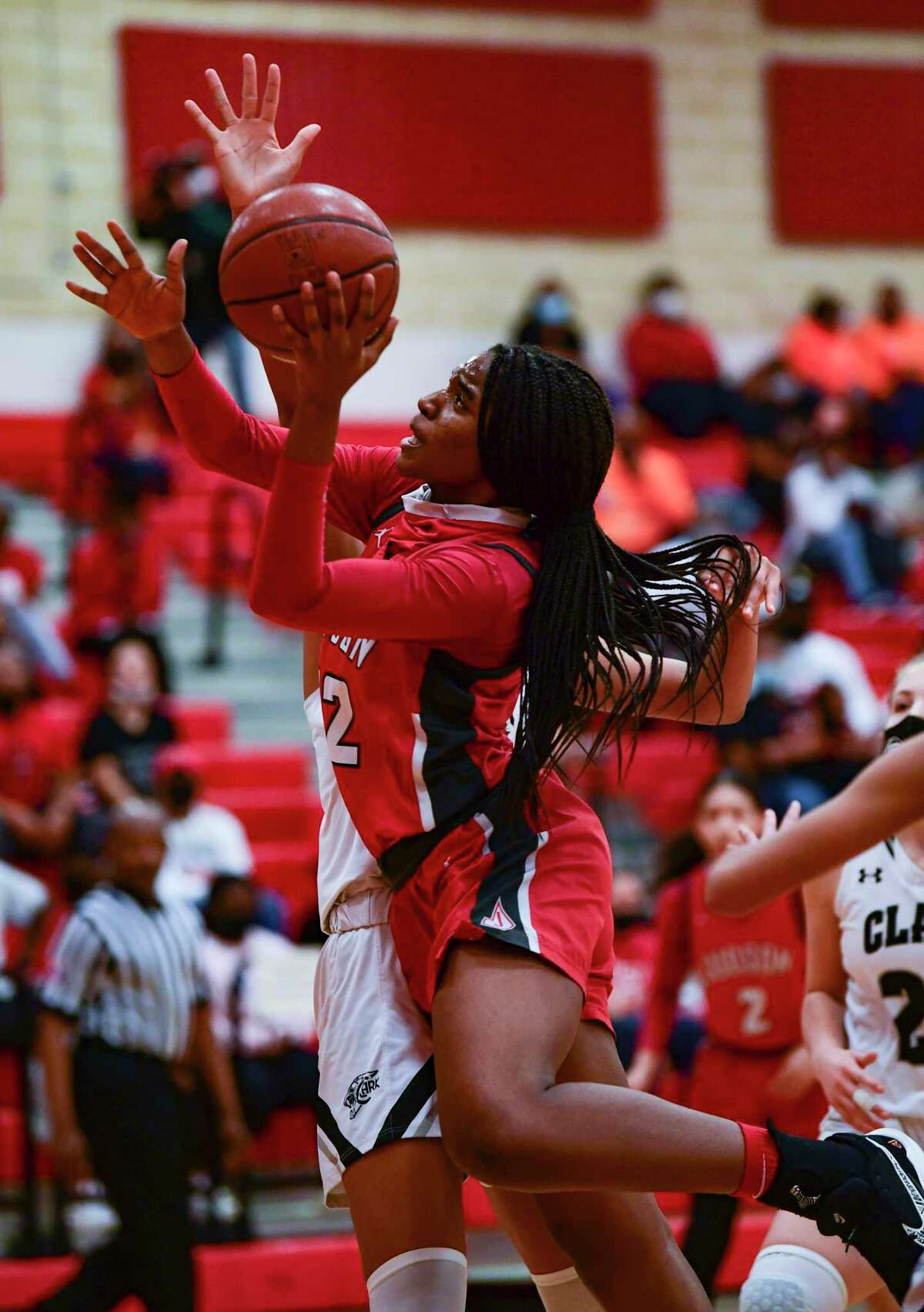 Amira Mabry of Judson shoots against Clark in girls basketball playoff action at Canyon High School on Wednesday, Feb. 24, 2021. Judson was victorious, 48-45.