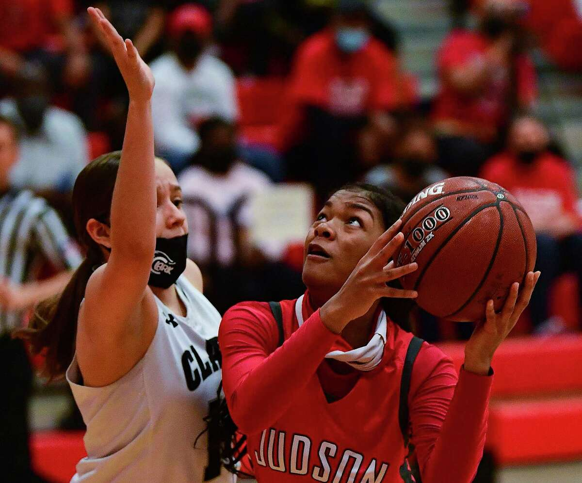 Kierstein Sanderlin (21) of Judson, penetrates as Madeline Gomez of Clark defends in girls basketball playoff action at Canyon High School on Wednesday, Feb. 24, 2021. Judson was victorious, 48-45.