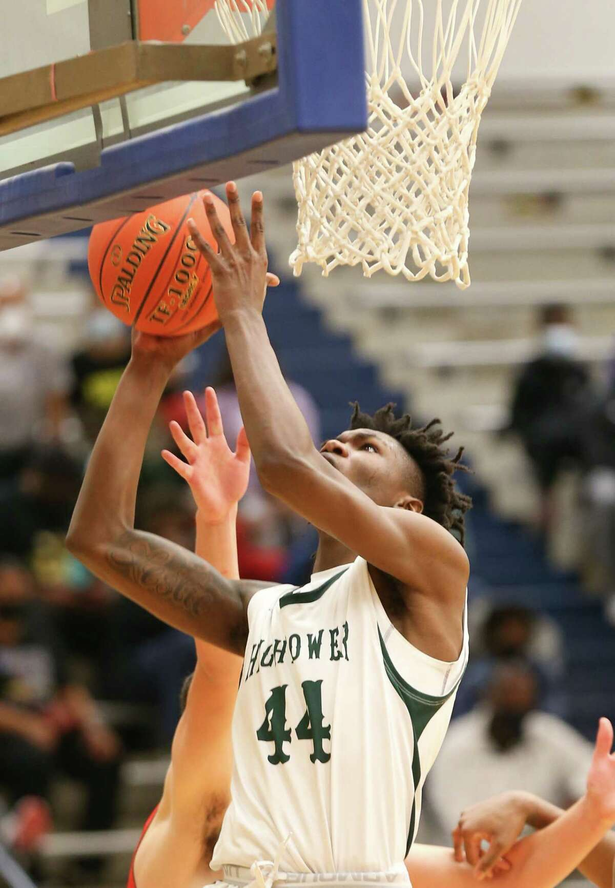 Hightower's Earnnest Barrow (44) puts up a shot against Crosby during playoff game action at Butler Fieldhouse in Houston on Wednesday, Feb. 24, 2021. Crosby won the game 68-54.