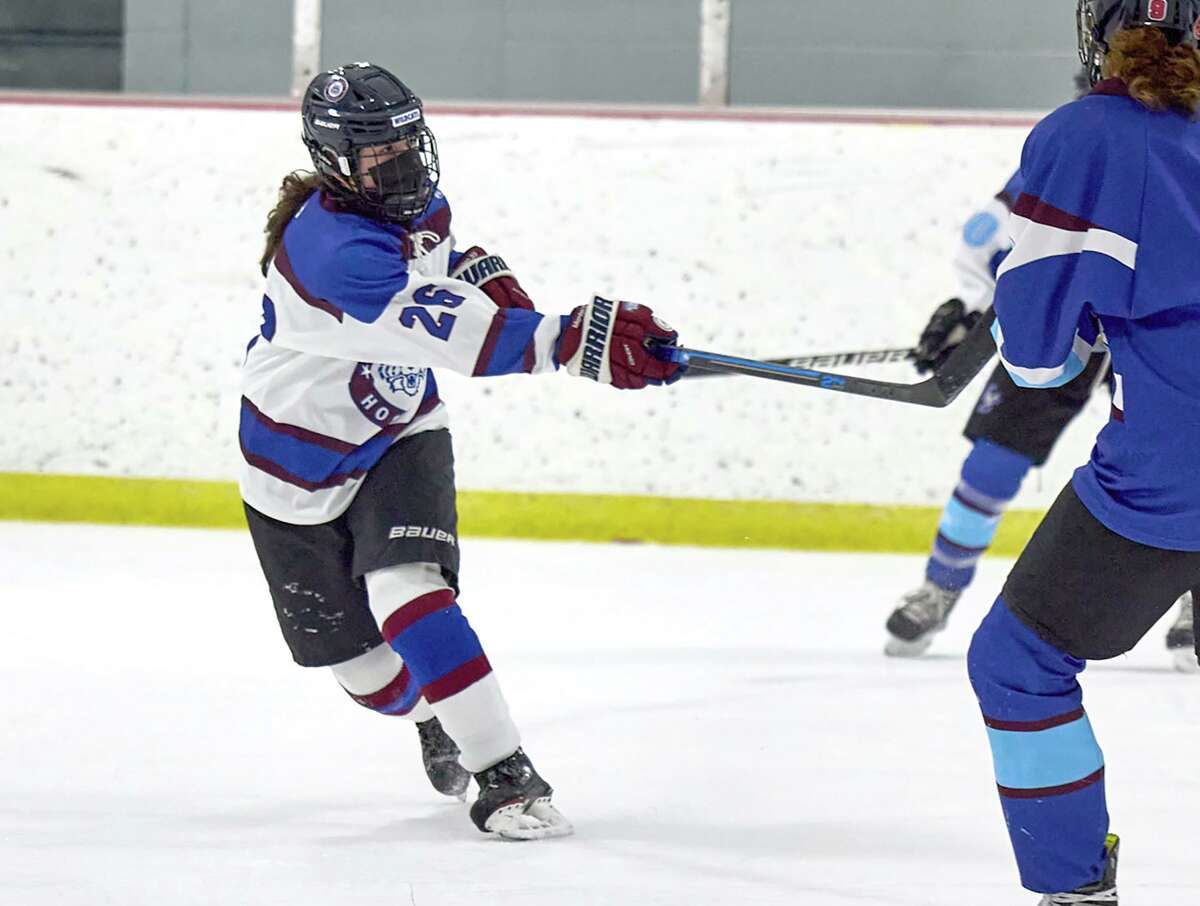 Brianna Morden (20) of the Suffield co-op follows through on a shot during the Wildcats' girls ice hockey game against the ETB Storm at Enfield Twin Rinks on Saturday, Feb. 20, 2021.