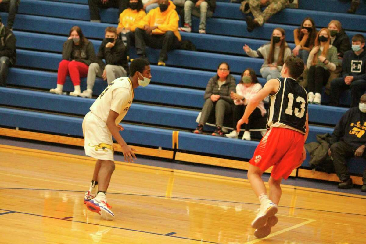 Baldwin's Carmelo Lindsey (left) focuses on defensive pressure in recent boys basketball action. (Star photo file)