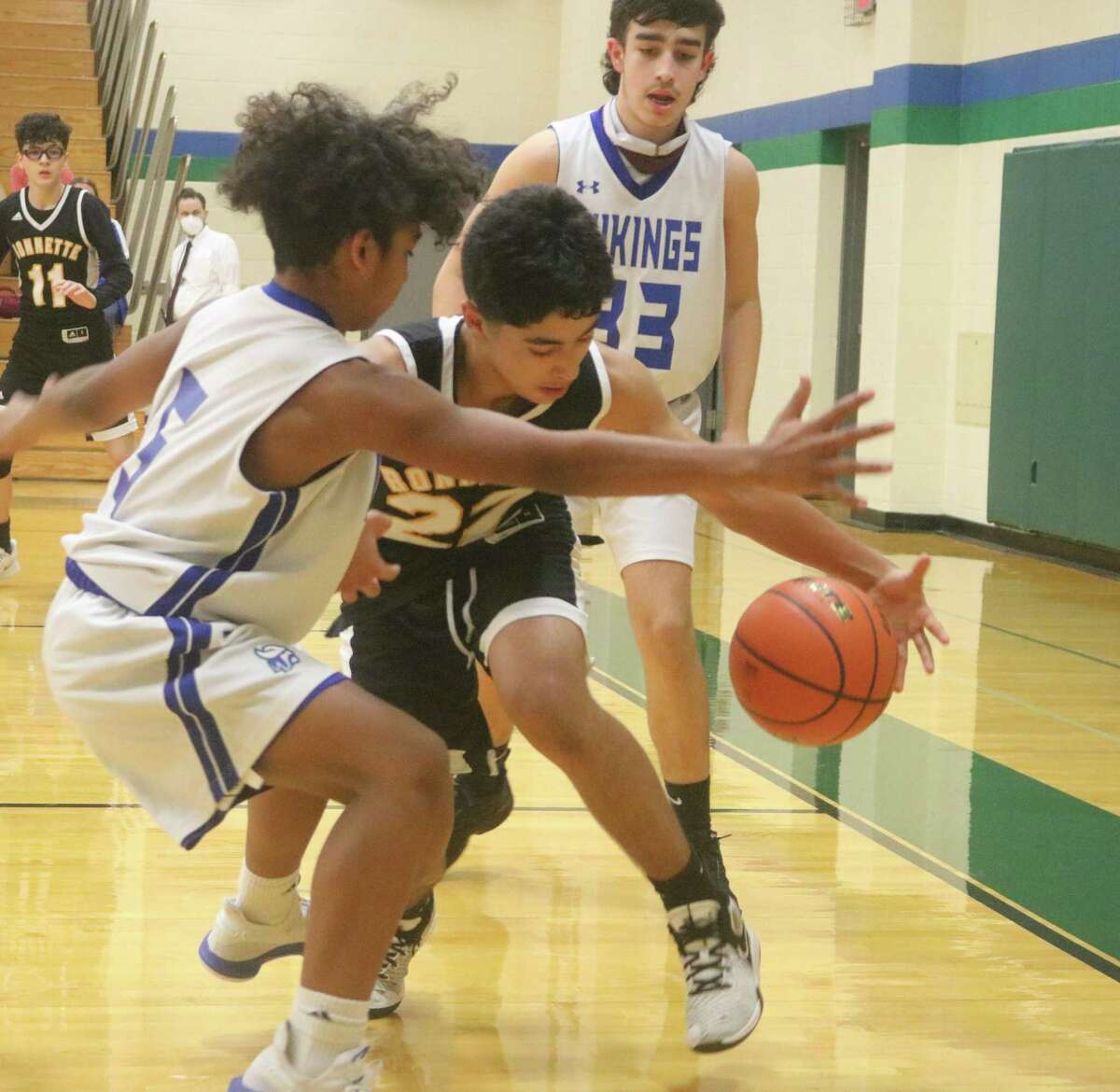Bonnette's Jose Gracia finds himself trapped by Andre Jackson during the final hectic moments Wednesday night. Looking on is Fairmont's Maddox Schultz (33), the team's leading scorer.