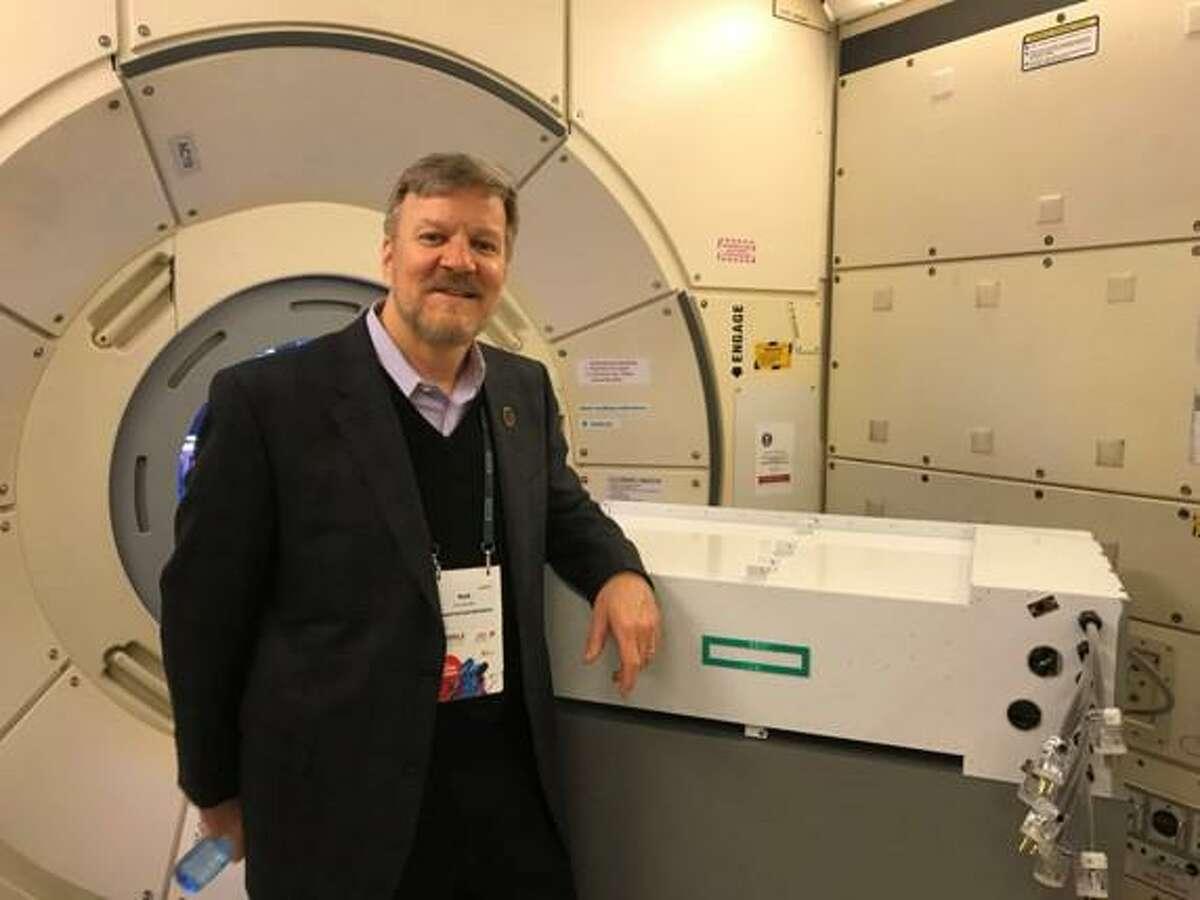 Mark Fernandez, Hewlett Packard Enterprise's principal investigator for Spaceborne Computer-2, with the original Spaceborne Computer that was launched into space in 2017. Spaceborne Computer-2 was launched into space on Feb. 20, 2021.