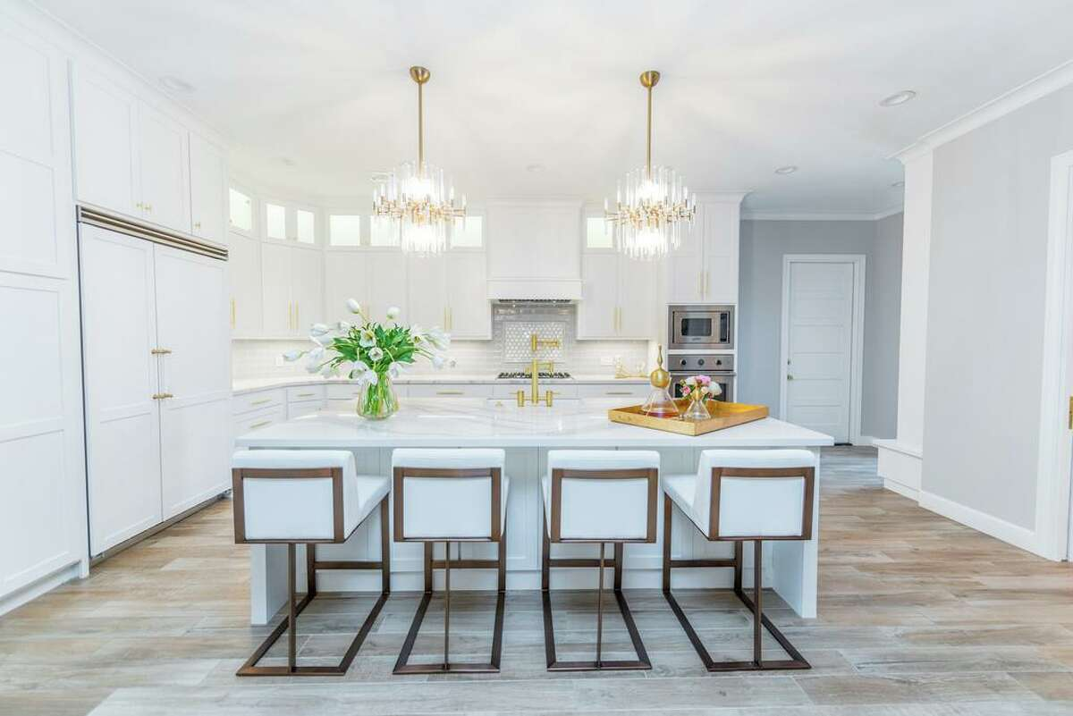Now, the kitchen in Brett and Jessica Calliers' Seabrook home is a picture of contemporary design with white cabinets, quartz counters and stylish lighting.