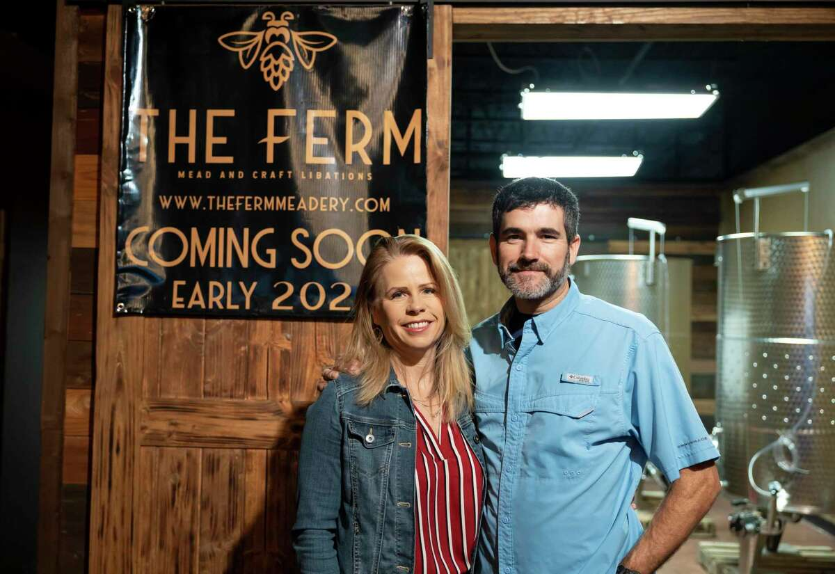 Mike and Cathy Rape pose for a portrait inside of their new business, The Ferm Meadery, Friday, Feb. 5, 2021, in downtown Conroe. The Ferm will operate as a new brewery and wine tasting room soon. The couple is very excited to open at 100 percent when they were expecting to open with capacity limits.