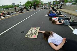 Several former and current Staples High School students organize a group of close to 1,000 protestors June 5 in downtown Westport. The group marched from the Post Road bridge to the police station in a peaceful protest against police brutality. Westport officials will issue surveys this spring as part of their effort to examine the district's equity, as well as get an idea of the issues facing students.