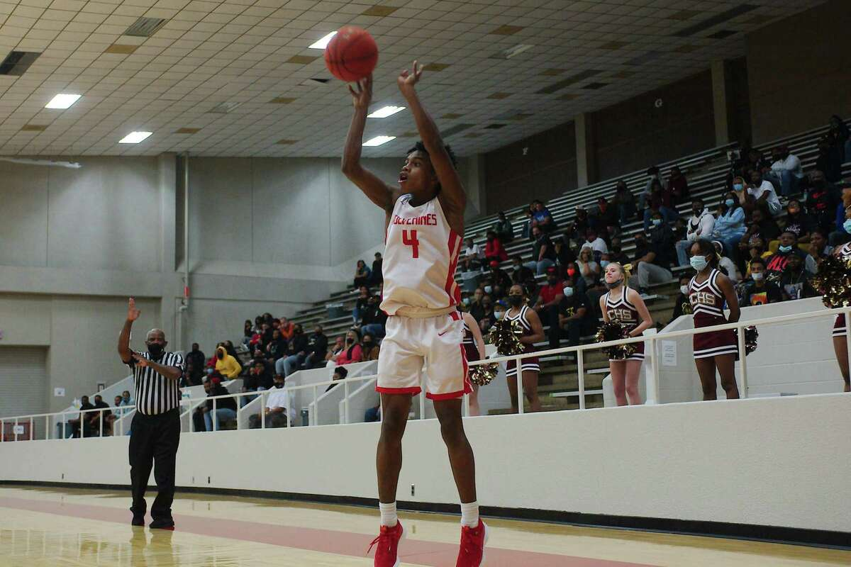 Clear Brook's Marcus Millender (4) fires a shot from the corner against Summer Creek Wednesday at Pasadena ISD Phillips Field House.