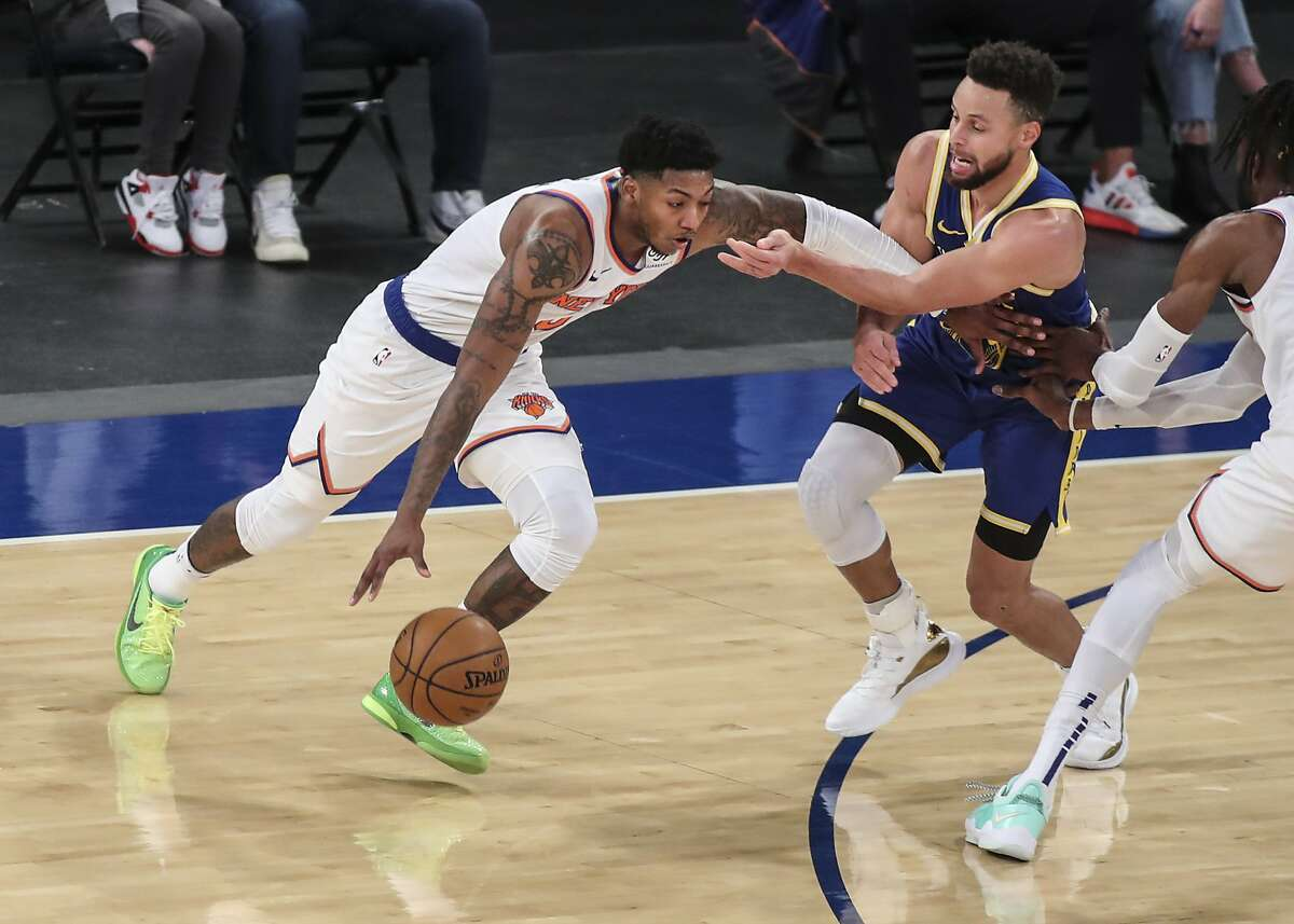 New York Knicks guard Elfrid Payton moves past Golden State Warriors guard Stephen Curry during the second quarter of Tuesday's game.