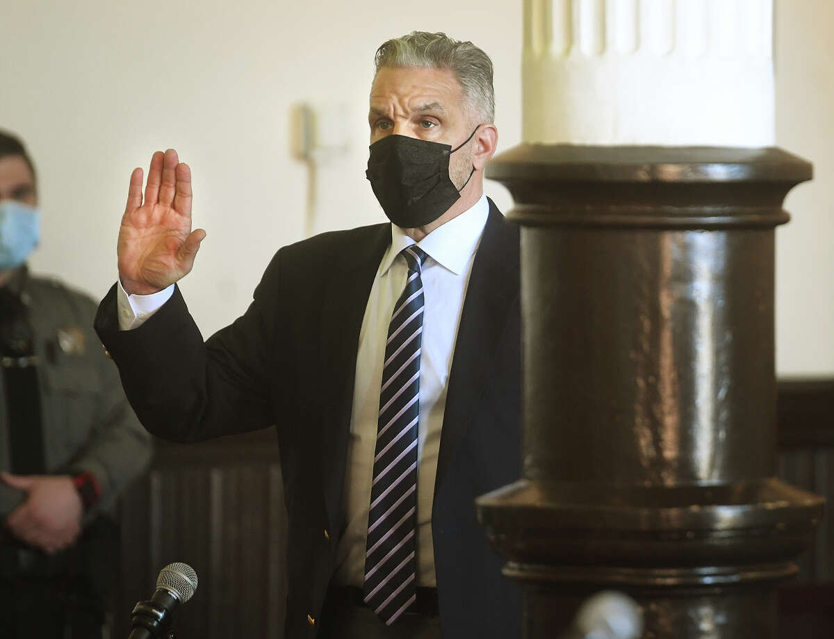 John Vazzano, of Trumbull, is sworn in during his arraignment on bribery charges in Superior Court in Bridgeport, Conn. on Thursday, February 25, 2021.