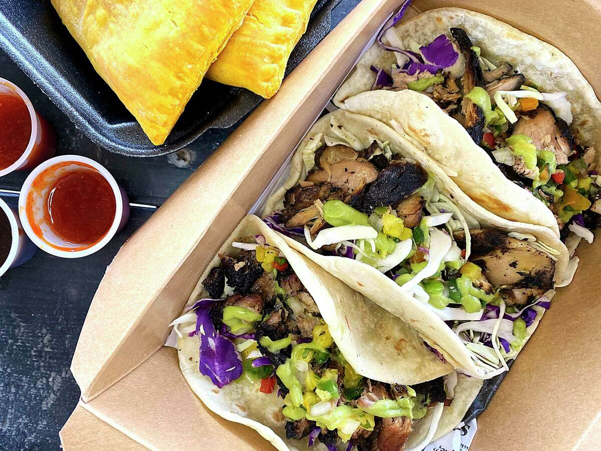 Jamaican beef patties, top, and jerk pork tacos are part of the menu at the popular Jamaican restaurant The Jerk Shack on Matyear Street on San Antonio's West Side.