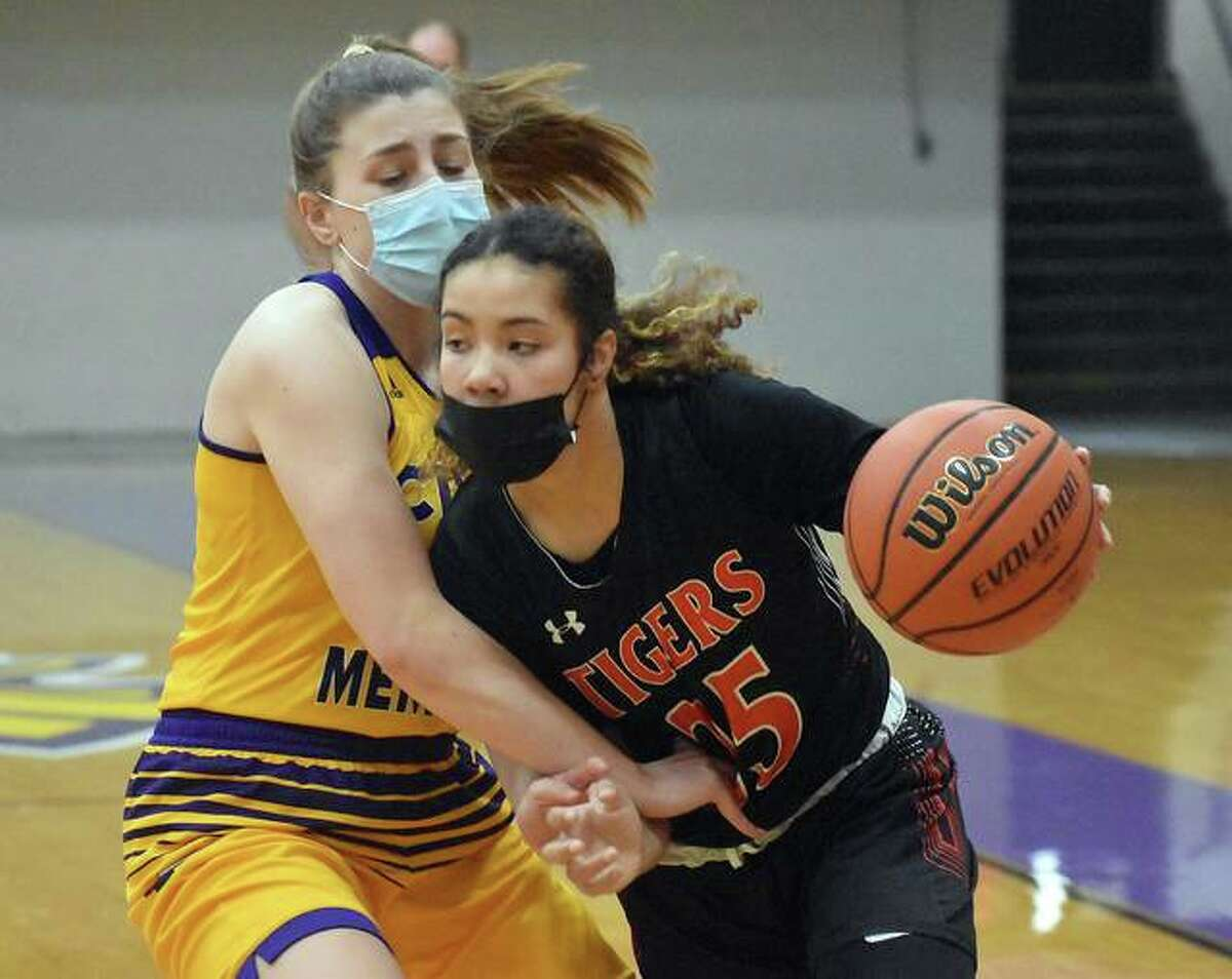 Edwardsville junior Sydney Harris takes the ball to the basket during a game against East St. Louis earlier this season.