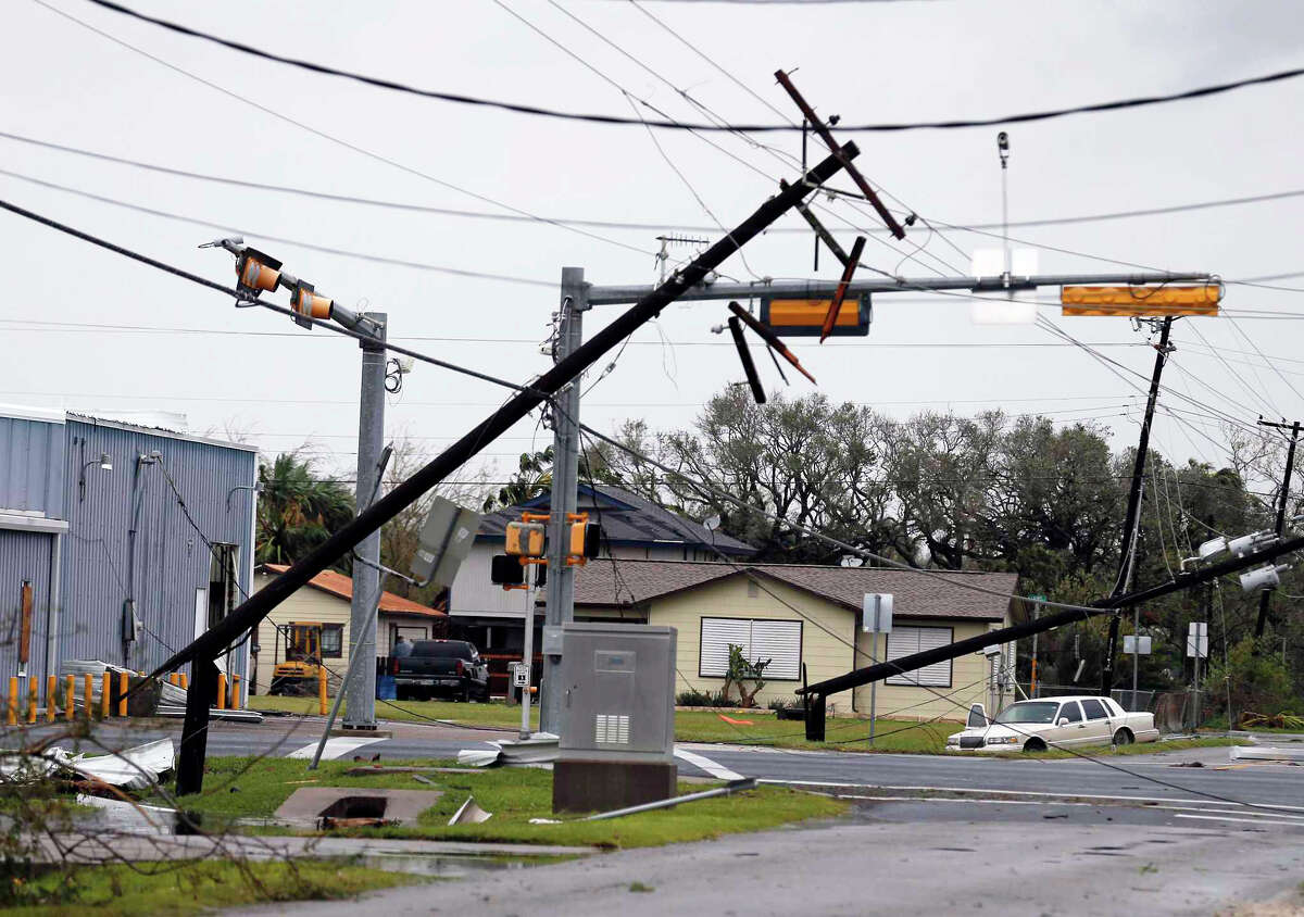 Downed utility poles litter the streets of Rockport, Texas in the aftermath of Hurricane Harvey on Saturday, Aug. 26, 2017. (Kin Man Hui/San Antonio Express-News)