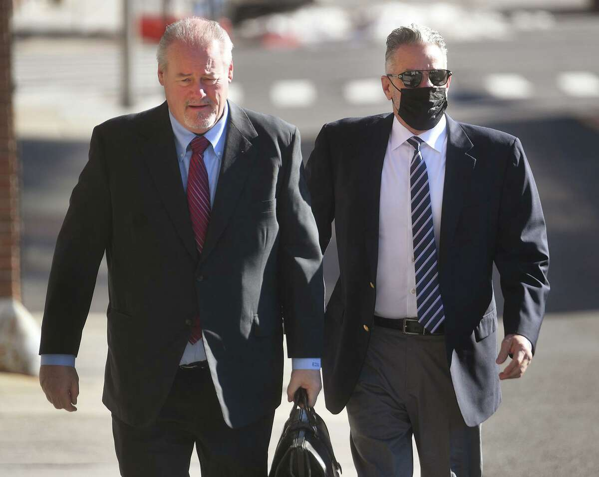 Accompanied by his lawyer Edward Gavin, left, John Vazzano, of Trumbull, arrives for his arraignment on bribery charges in Superior Court in Bridgeport, Conn. on Thursday, February 25, 2021.