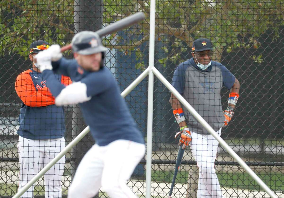 Houston Astros manager Dusty Baker watches outfielder Chas McCormick (6) bat during spring training workouts for the Astros at Ballpark of the Palm Beaches in West Palm Beach, Florida, Thursday, February 25, 2021.