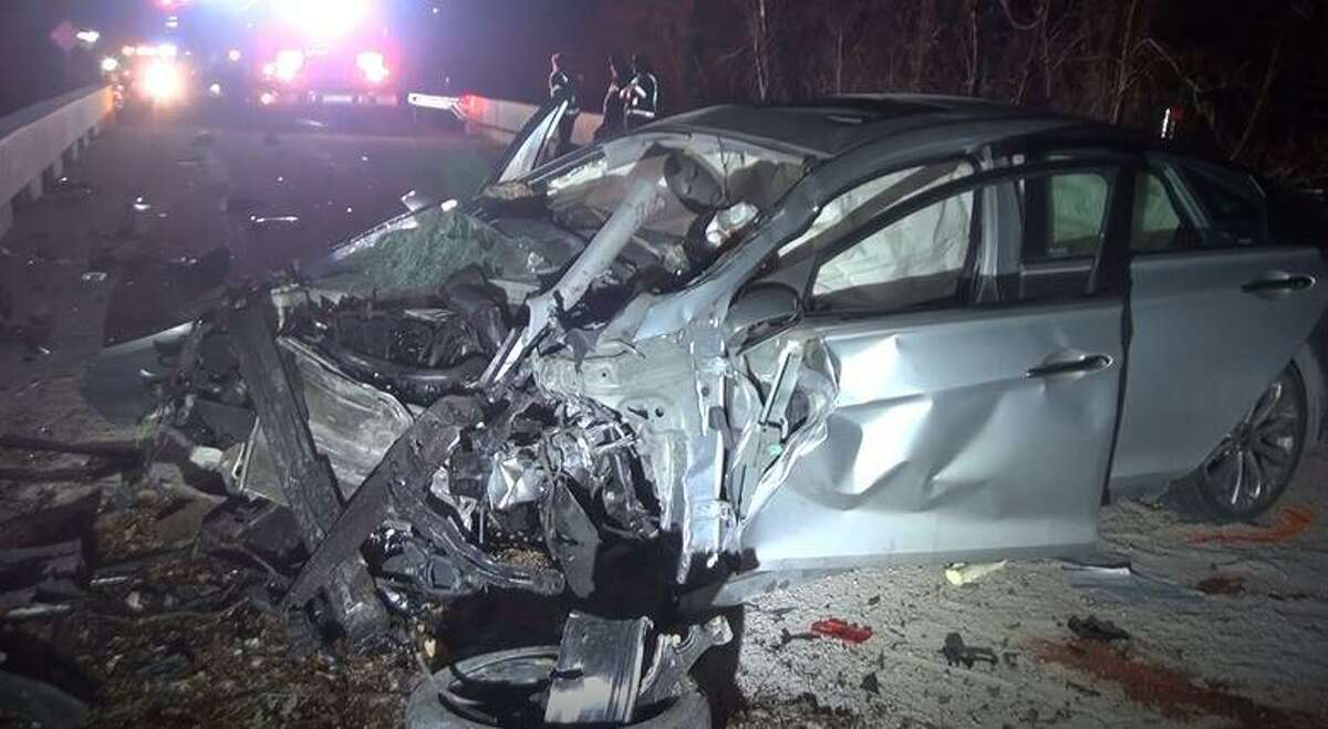 A Hyundai Sonata is seen after a crash Wednesday, Feb. 24, 2021 on a bridge on Mt. Mariah Road in northwest Montgomery County that left two dead.