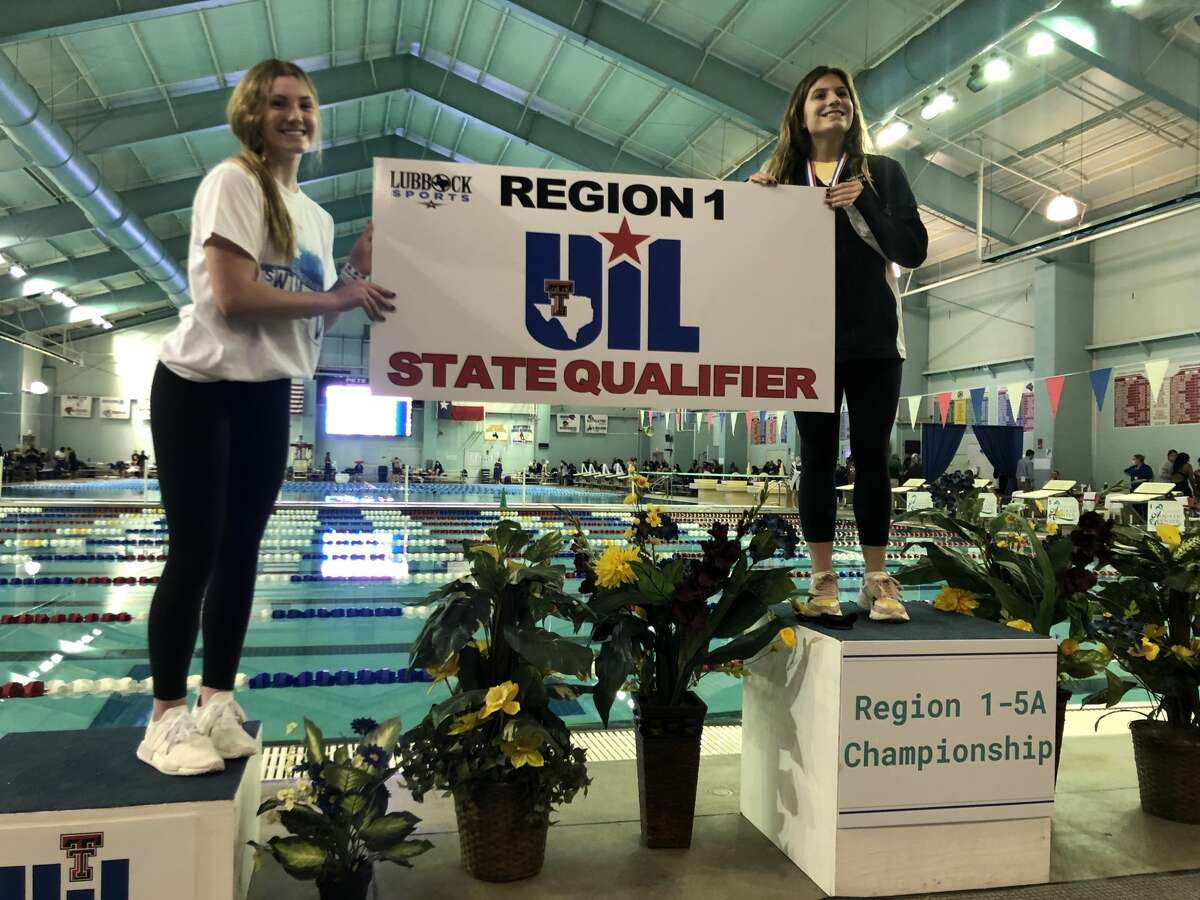 Greenwood junior Grace Austin, left, stands atop the podium after placing second in the girls 1-meter dive event at the Region I-5A meet, Feb. 4 in Lubbock. Austin qualified for her third straight state meet.