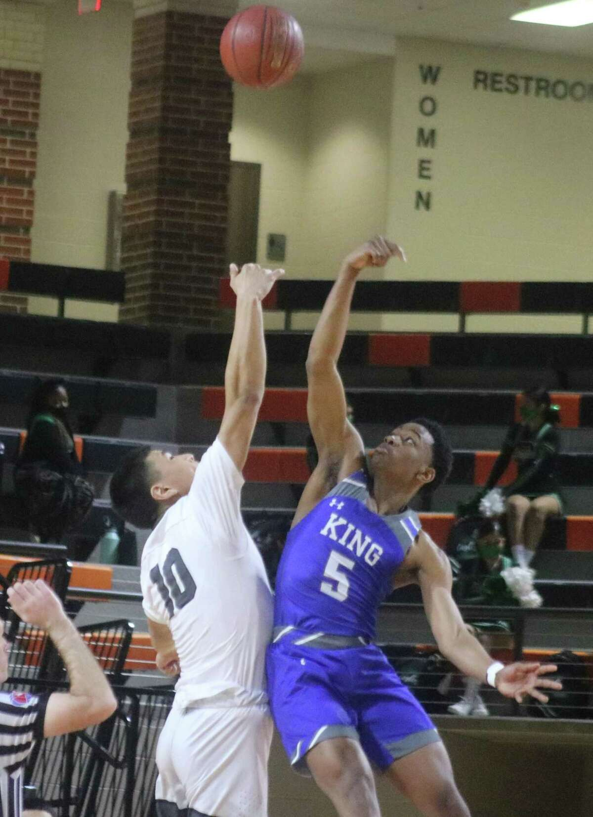 Pasadena Kevin Juarez and C.E. King's Davonte Curry contest the opening tipoff to the bi-district game Monday night. When Juarez goes for the opening tipoff tonight at 7, it will be Pasadena's first appearance in an Area title game since 1993.
