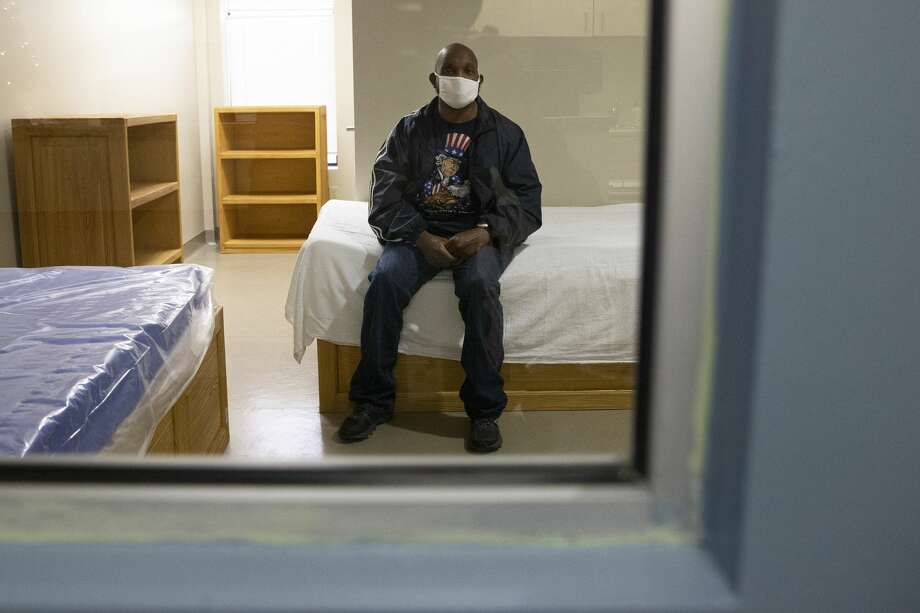 A patient at the Judge Ed Emmett Harris County Mental Health Diversion Center in Houston poses for a photograph in a room in December 2020. The center opened in fall 2018 as a way to connect mentally ill individuals to services rather than jail. As of Jan. 31, 2021, there have been about 3,500 diversions to the center. Photo: Yi-Chin Lee/Staff Photographer / © 2020 Houston Chronicle
