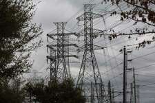 Power lines in Houston. By the time the state's grid manager forecast that the severe winter weather would drive record demand, the options to respond were limited.