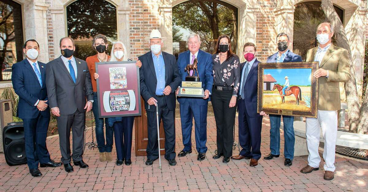 Laredo International Fair and Exposition's Rancher of the Year Jerome Jordan, fifth from left, is joined by family, representatives from Texas Community Bank, Laredo College and L.I.F.E fair, Wednesday, Feb. 24, 2021, outside of Texas Community Bank during the announcement for Rancher of the Year.