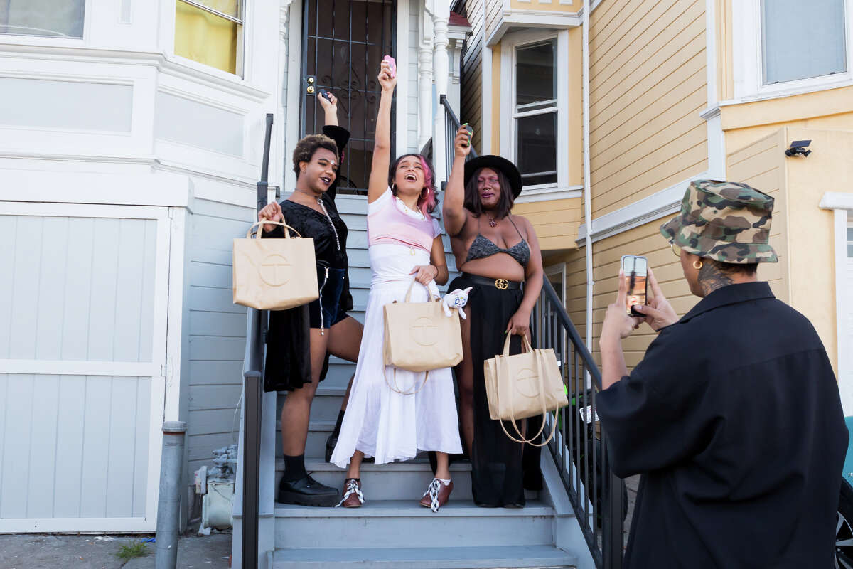 Guerilla Davis takes a photo of Yasmine Rosa, Fiera Ferrari and Nikita Lewis in Oakland, Calif.