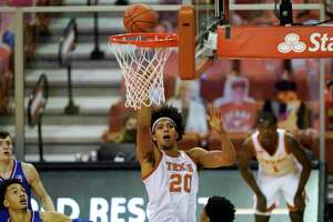 Texas forward Jericho Sims drives to the basket during the first half of an NCAA college basketball game against Kansas, Tuesday, Feb. 23, 2021, in Austin, Texas. (AP Photo/Eric Gay)