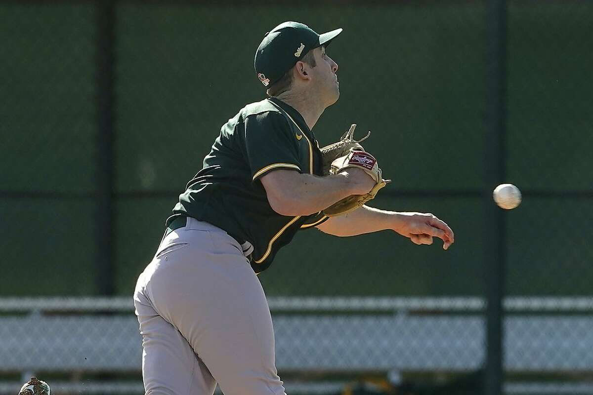 Oakland Athletics pitcher Adam Kolarek, here throwing Thursday in spring training, went to a sidearm delivery while playing in Double-A in 2015.