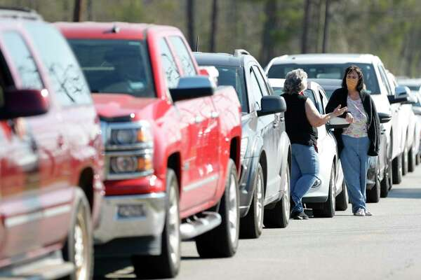 Continued gridlock at Interstate 45 and Texas 242 Wednesday, forcing CHI St. Luke's Health The Woodlands to cut its efforts to administer second dose COVID-19 vaccination for the second time this week. In this file photo, residents wait to take part in a drive-thru COVID-19 vaccination at the East Montgomery County Senior Center Feb. 3 in New Caney.