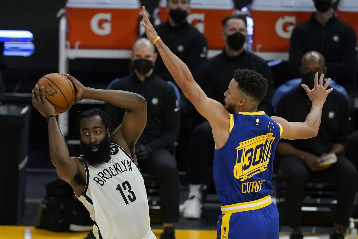 Warriors guard Stephen Curry defends Brooklyn guard James Harden during a Feb. 13 game at Chase Center.
