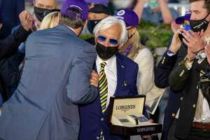 LEXINGTON, KY - NOVEMBER 07: Trainer Bob Baffert celebrates with owners of Authentic after the horse won the Breeders Cup Classic at Keenland on November 7, 2020 in Lexington, Kentucky.