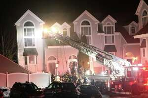Danbury firefighters battled a fire at a condo complex on Deer Hill Avenue on Wednesday, Feb. 24.
