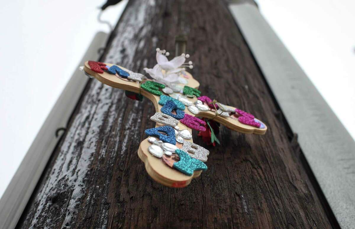 A memorial at the site of a car meet held Sunday, where authorities said a street takeover happened and a crash resulted in the deaths of three people. The site was photographed Thursday, Feb. 25, 2021, in Houston.