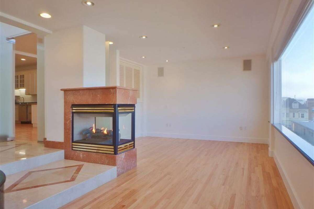 There's a double-sided gas fireplace in the bedroom and adjacent to the large bathroom area.