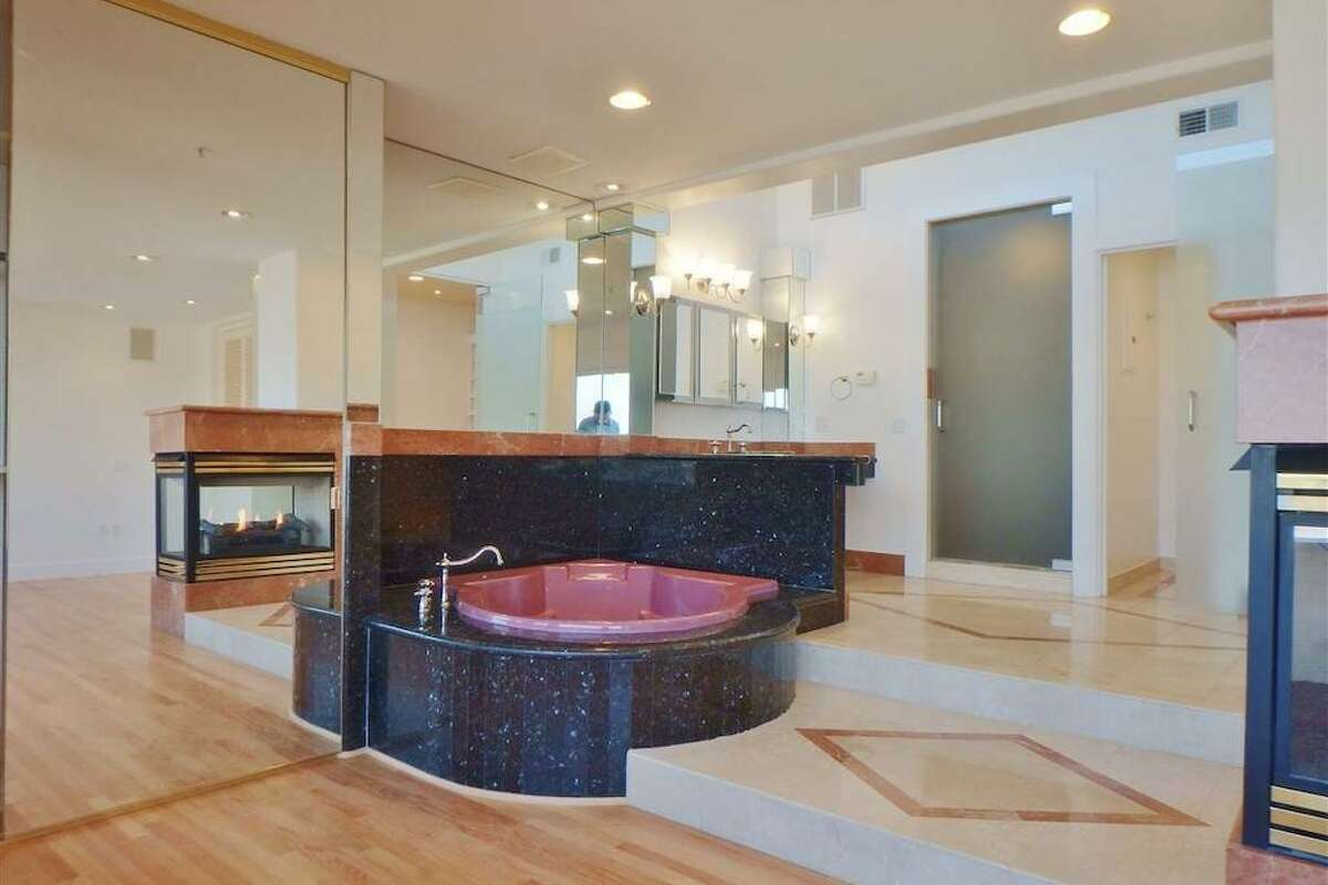 The bathroom area has a large steam shower with three faucets and a separate W.C.