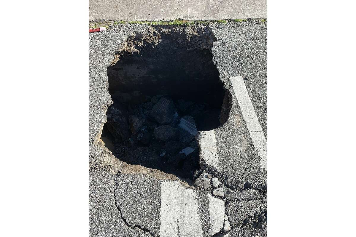 A sinkhole on Interstate 280 northbound at the 6th Street off-ramp in San Francisco on Feb. 25, 2021.