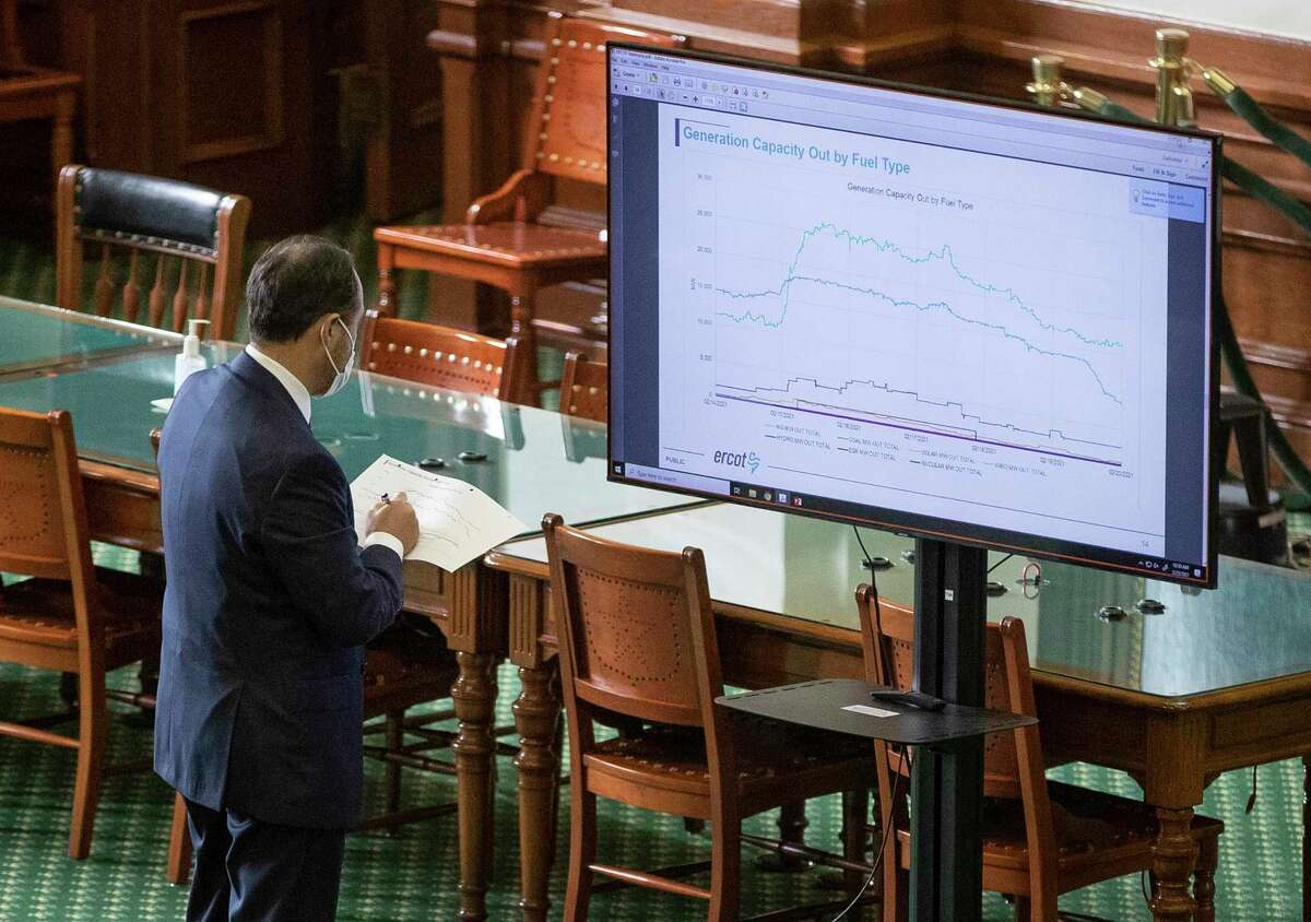 State Sen. Jose Menendez, D-San Antonio, takes notes during the Senate Committee on Business and Commerce in the Senate Gallery at the Capitol about the power outage during the during last week's deadly winter freeze, Thursday Feb. 25, 2021, in Austin, Texas. (Jay Janner/Austin American-Statesman via AP)