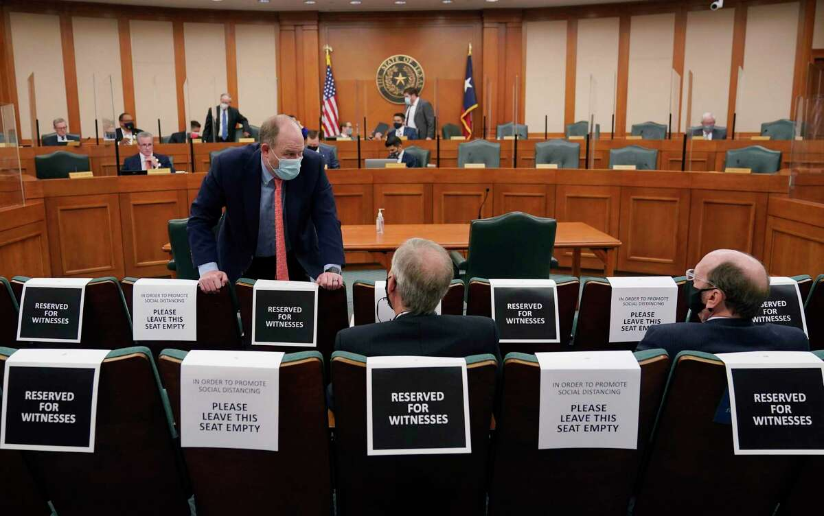Witnesses wait to testify as the Committees on State Affairs and Energy Resources holds a joint public hearing to consider the factors that led to statewide electrical blackouts, Thursday, Feb. 25, 2021, in Austin, Texas. The hearings were the first in Texas since a blackout that was one of the worst in U.S. history, leaving more than 4 million customers without power and heat in subfreezing temperatures. (AP Photo/Eric Gay)