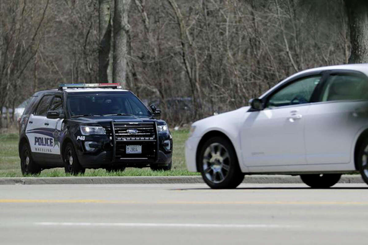 A Wheeling police officer checks the speed of the vehicles in April.