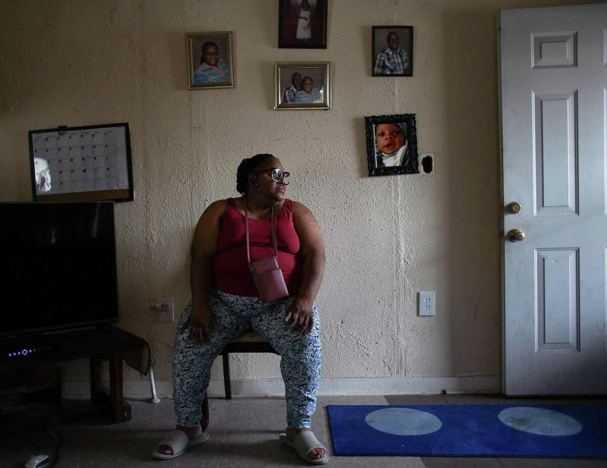 Shonza Branch, 56, sits in her northeast Houston on Thursday, Feb. 25, 2021. Her home was heavily damage during Hurricane Harvey, and she has been unable to fully repair it. During last week's storm, she lost water and has gone without for over a week.