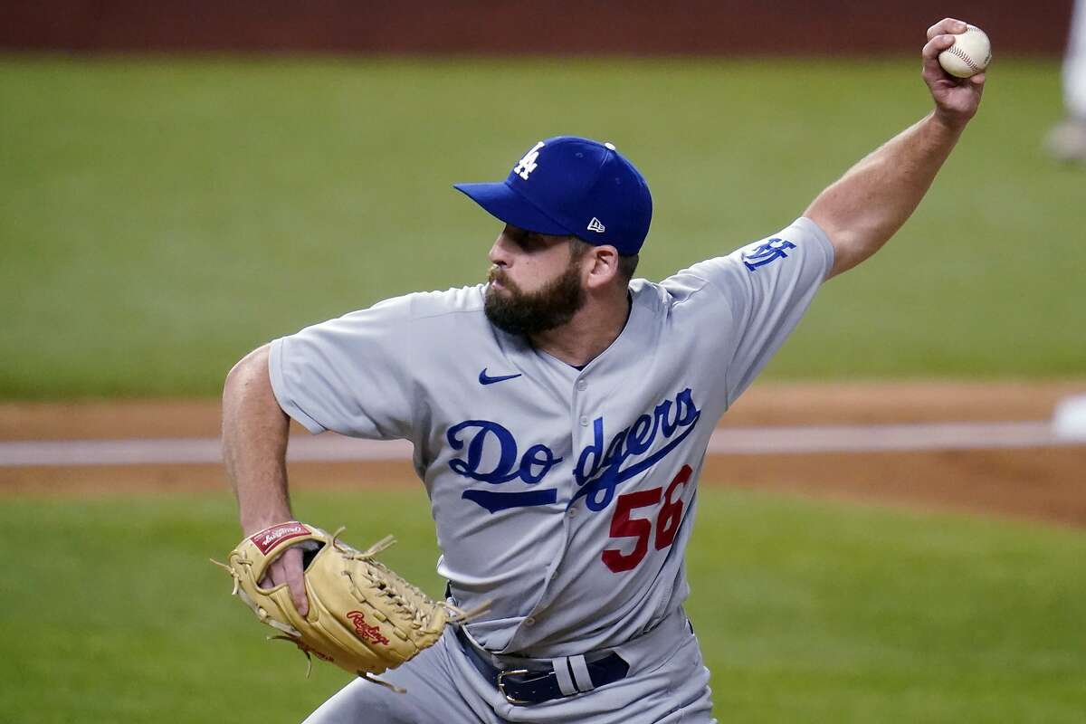 """New A's pitcher Adam Kolarek has held left-handed hitters to a .176 average in his 143 big-league appearances. In 46 games with the Dodgers the last two years, he posted a 0.88 ERA in 30 ?..."""" innings."""