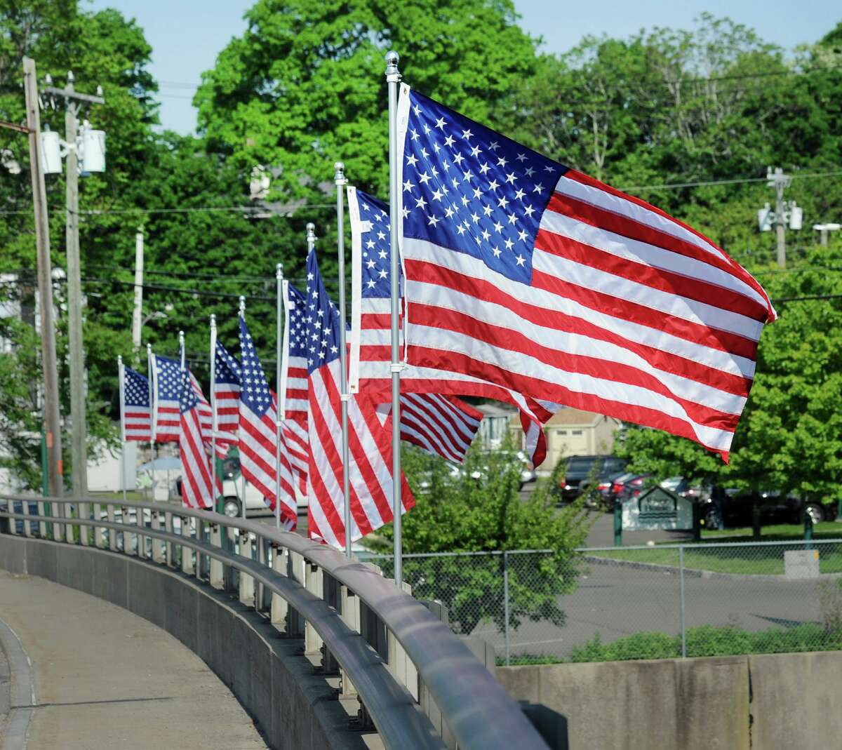 The American flags are up on the David N. Theis Memorial Bridge that spans the Mianus Waterway in Greenwich, Conn., Friday, May 25, 2018. A similar program could be coming to Greenwich Avenue this summer.