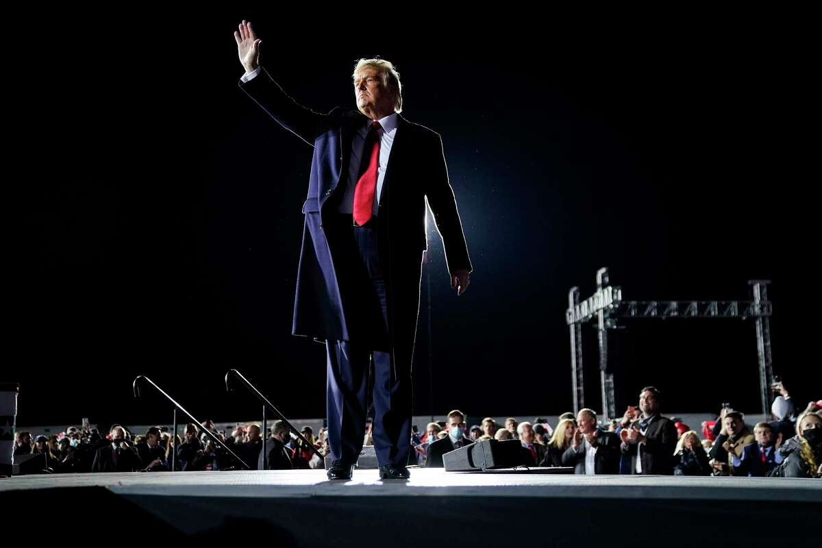 President Donald Trump addresses a Jan. 4 campaign rally in Dalton, Ga., on the eve of the runoff elections lost by Republican incumbent Sens. Kelly Loeffler and David Perdue.