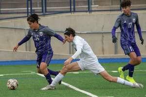 Midland High's Alexander Marquez steals the ball away from Frenship's Owen Navarrette 02/25/2021 at Grande Communications Stadium. Tim Fischer/Reporter-Telegram