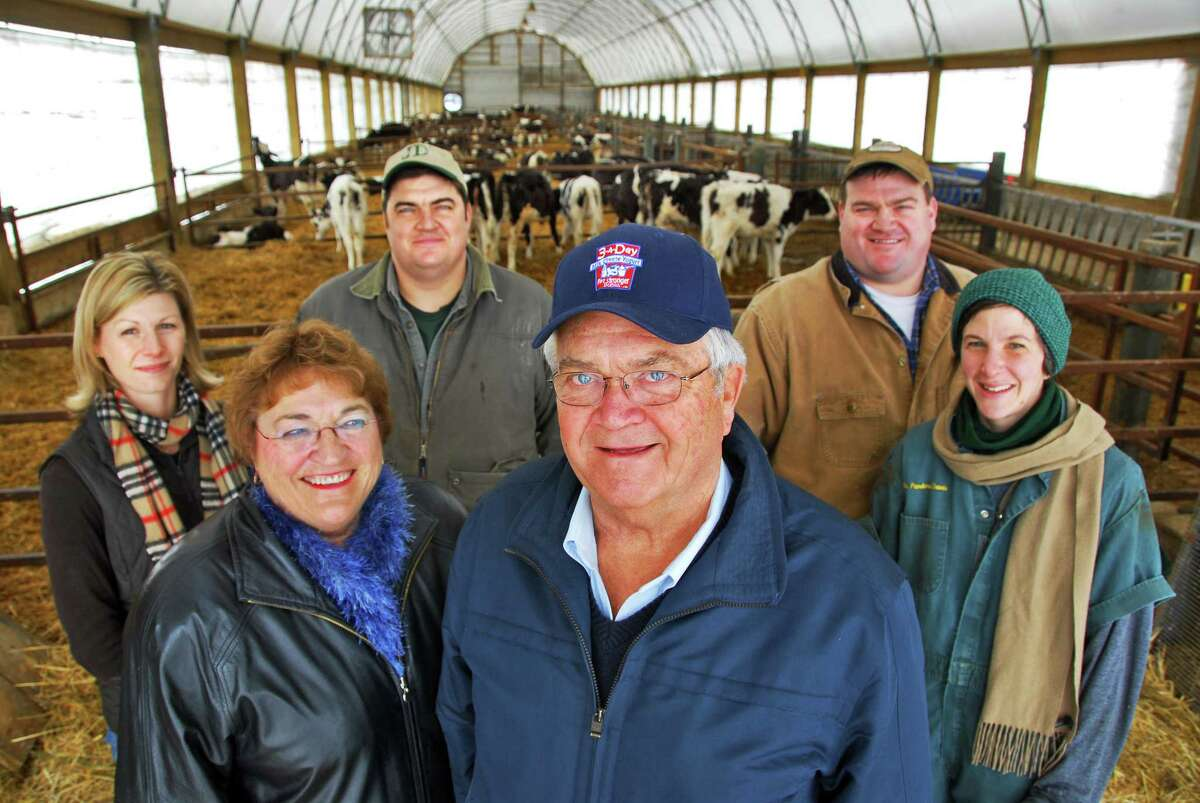 The King family, patriarch Edgar King,center, his wife Carolyn, son Jeff King and his wife Becky King (back row left), son Jan King and his wife Pandora Davis (far right) in the calf barn at the King-Ransom Farm in Northumberland February 2008. Edgar King died Feb. 21, 2021.