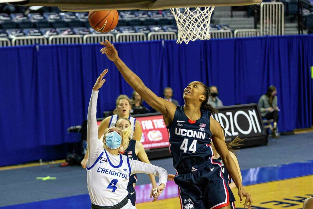 UConn's Aubrey Griffin (44) blocks a layup by Creighton's Temi Carda (4) during a February game in Omaha, Neb.
