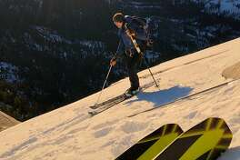 Zach Milligan (pictured) and Jason Torlano look down into Yosemite Valley during a ski descent of Half Dome