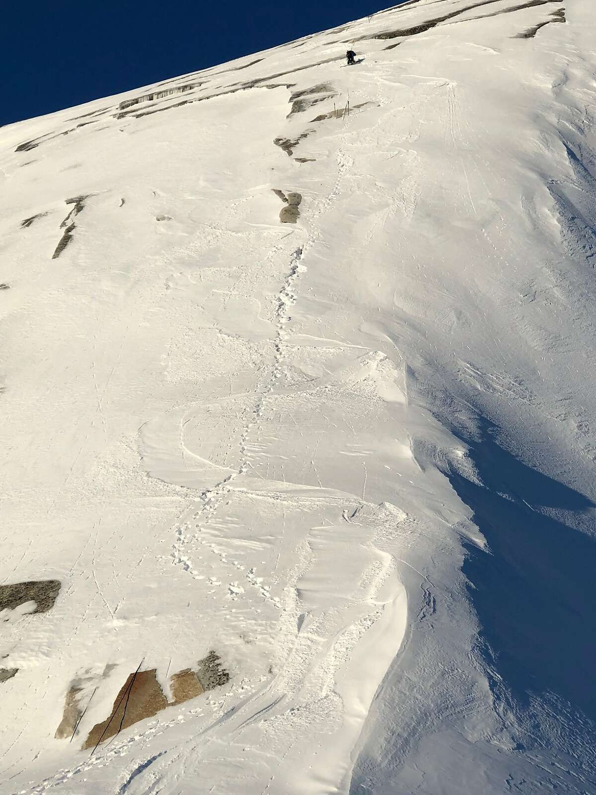 Zach Milligan works his way down the side of Half Dome during the ski descent
