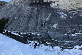 Zach Milligan pauses during a ski descent of Half Dome in Yosemite