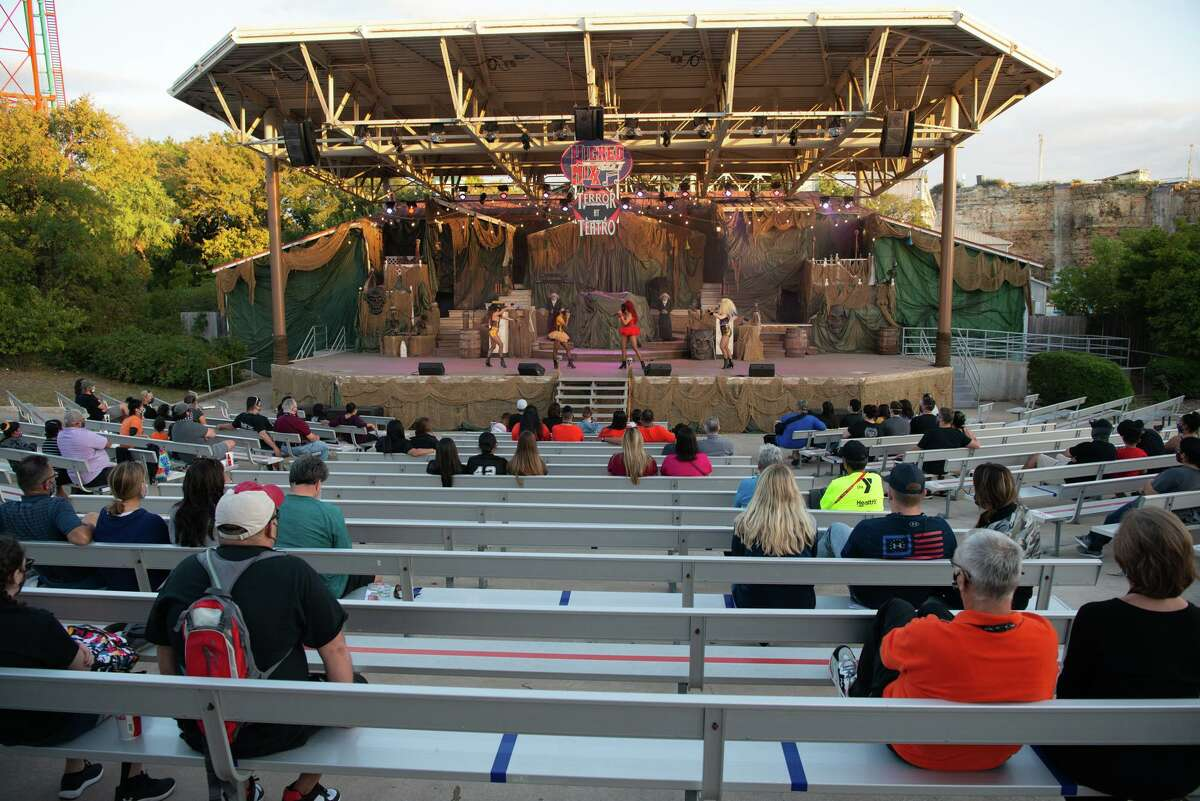 Guests are socially distanced during a performance at the Sundance Theater during Halloween activities at Six Flags Texas. The haunted houses moved outdoors with social distancing and mask protocols put in place.